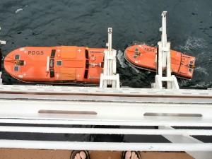 Lowering Two Life Boats to Use as Tenders