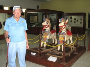 John in Front of Rocking Horses at the Nusa Tenggara Province Museum